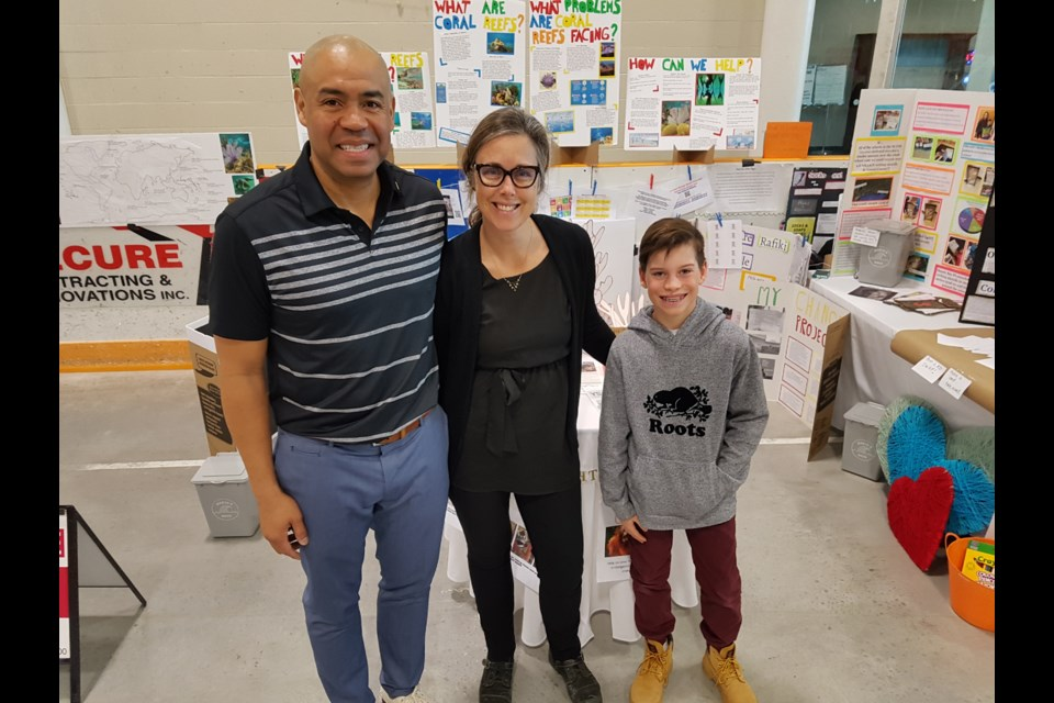Ingram Nurse (left), Julie Johnson (middle), Caden Fowler (right) get ready for a busy day at the Be Green Show. Shawn Gibson/BarrieToday