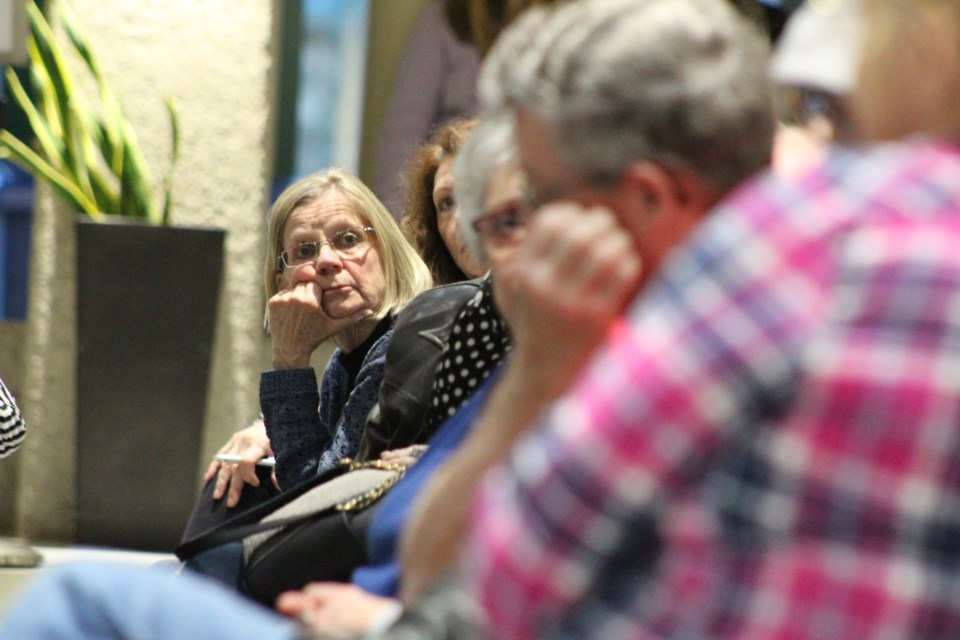 A woman listens during a town hall meeting on the opioid crisis, April 24, 2019 at Barrie City Hall. Raymond Bowe/BarrieToday