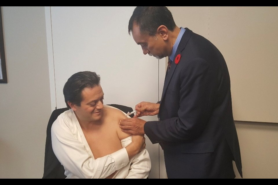 Barrie Mayor Jeff Lehman, left, receives his flu shot from Ontario Medical Association president Dr. Sohail Gandhi. The two met briefly on Monday to get acquainted and discuss the importance of immunization in the community. Photo courtesy Ontario Medical Association.