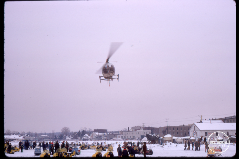 A helicopter hovers over Kempenfelt Bay during the 1973 Winter Carnival. Photo courtesy of the Barrie Historical Archive