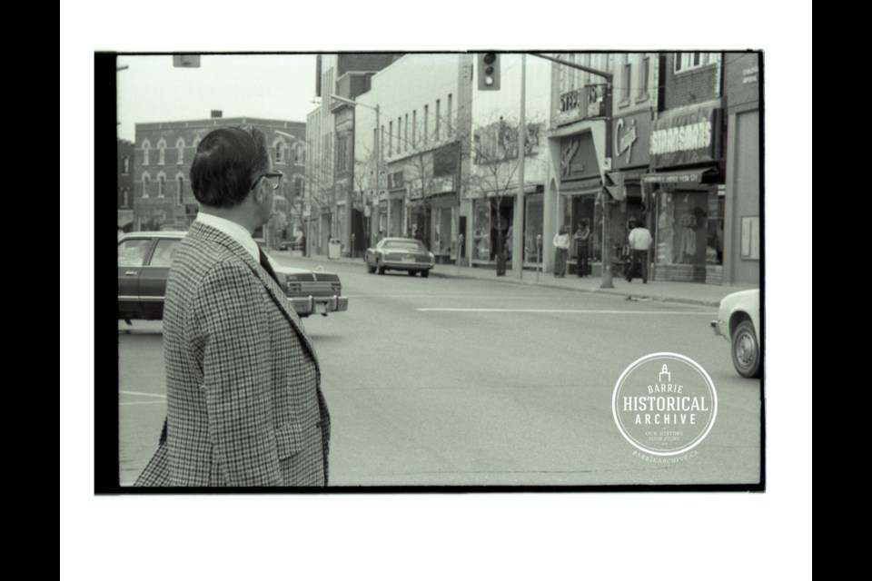 Mayor Ross Archer looking over the businesses on the north side of Dunlop Street Eastm east of Five Points, in 1978. Photo courtesy of the Barrie Historical Archive