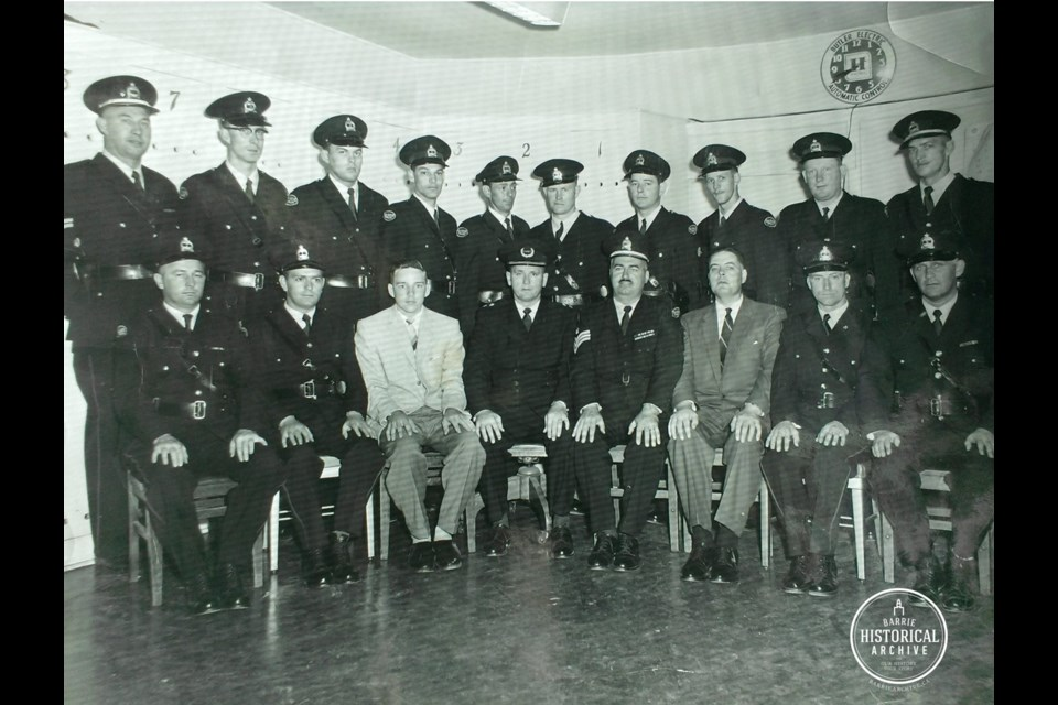 Const. Roy A. Lacey and his fellow officers not long after the Barrie police department was reformed in 1956.