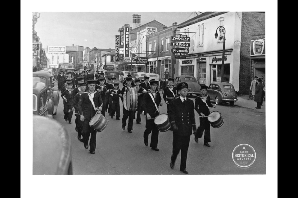 A marching band heads down Dunlop Street West, then known as Elizabeth Street, circa 1945. Photo courtesy of the Barrie Historical Archive