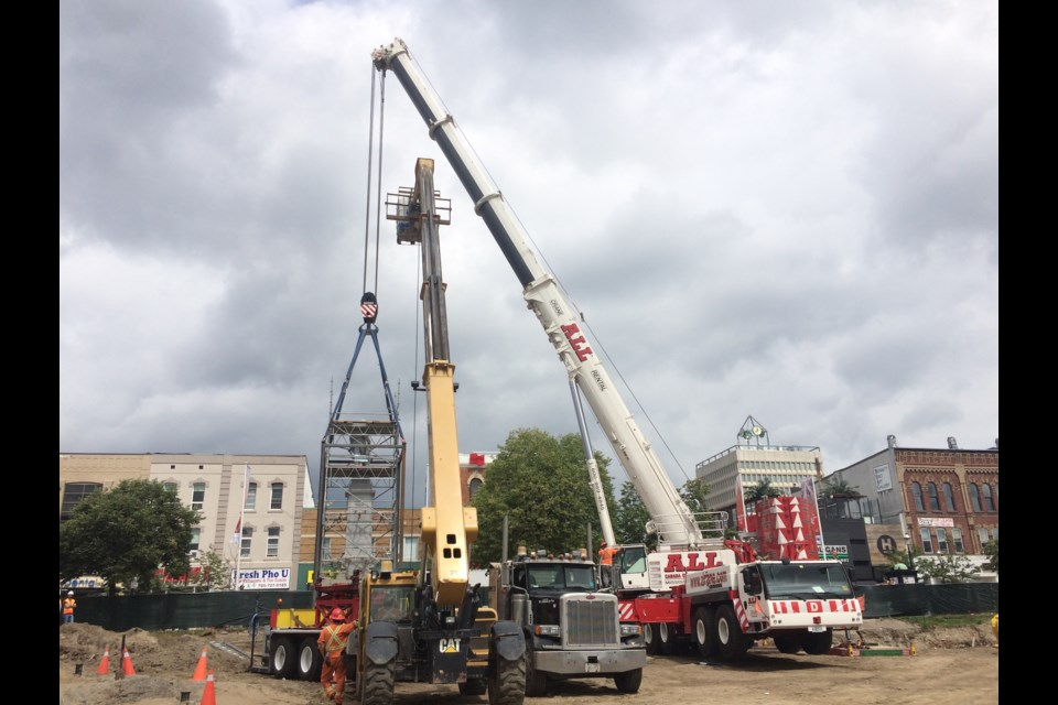 A crane picks up the 195,000-pound cenotaph on Friday, Aug. 18, 2017. Laurie Watt for BarrieToday