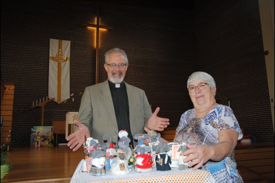 Rev. Dr. Colin MacDonald and long-time crafter Ann Macklem show the collection of church mice. Laurie Watt for BarrieToday