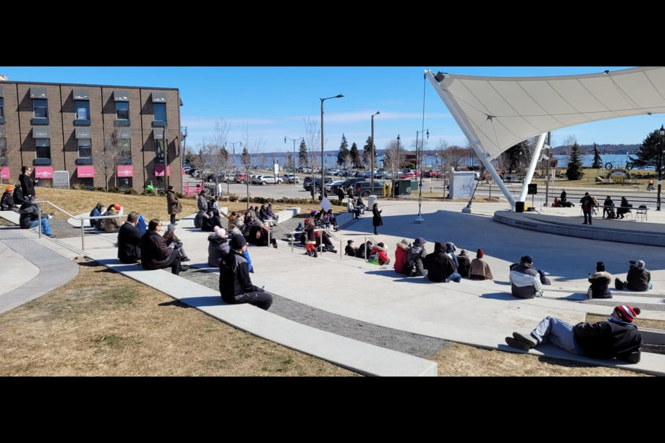 People gathered at a March 13 protest at Meridian Place to voice their disdain for the current COVID-19 restrictions.