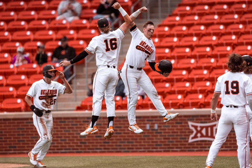 Midhurst's Max Hewitt (right, in air) was offered a contract by the L.A. Dodgers last week.