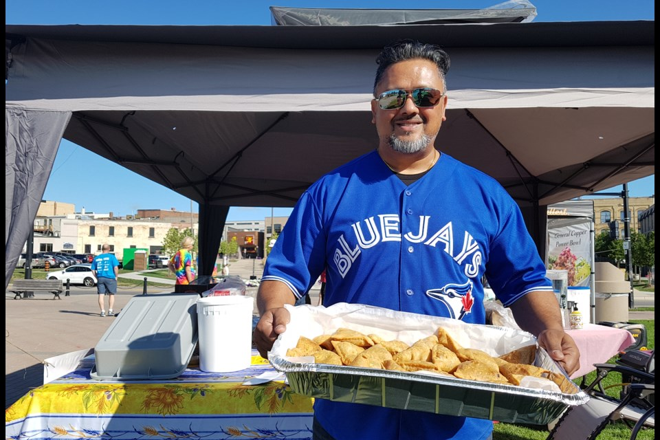 Naren Persaud with a tray full of samosas at a recent downtown Barrie event, Wednesday, Aug. 28, 2019. Shawn Gibson/BarrieToday