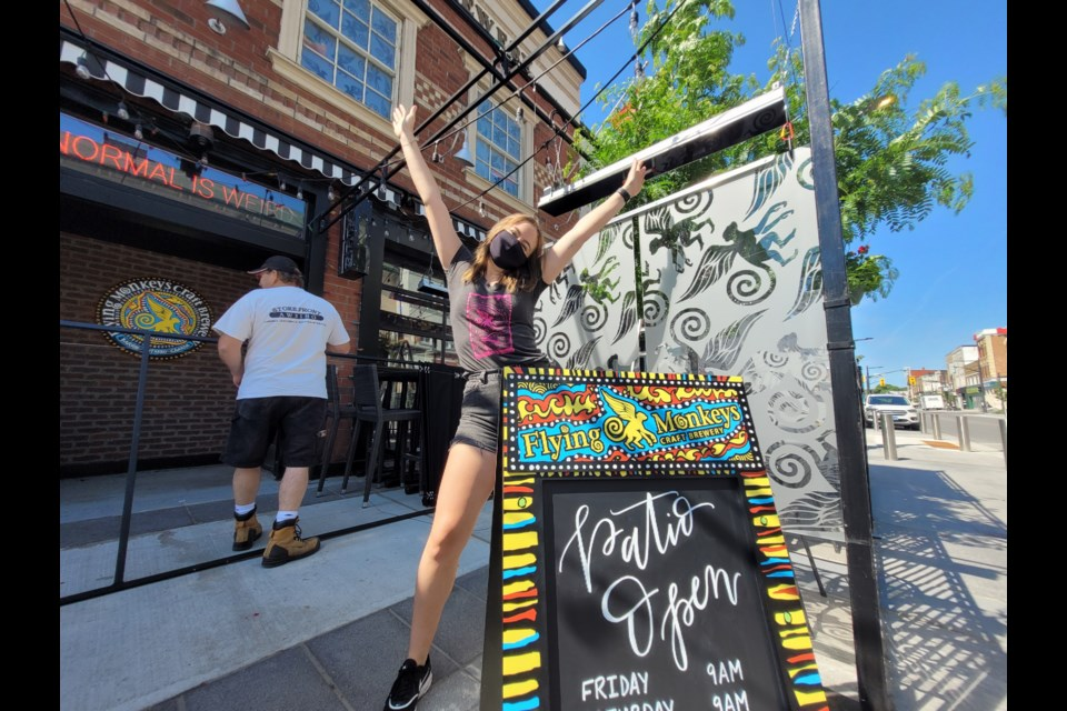 Flying Monkeys supervisor Alex Hackett is ready with open arms for Friday's patio season to begin.