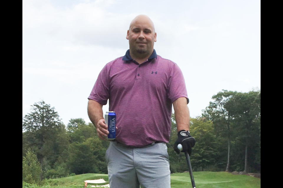 Troy Scott loved to golf and loved his community. The town has voted to name the Community Fridge project in his honour.