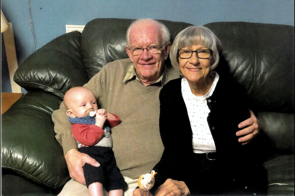 Carl Jory, resident at Woods Park Retirement Residence in Barrie, is a veteran who served as a mechanic in the air force. He is pictured with his wife, Martha, and their great-grandson. Photo provided