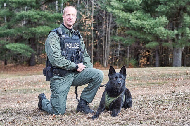 Barrie police Const. JohnLamont takes a breather with his now-retired canine partner, Thor, in this undated photo. Lamont, who is now working with police dog Thunder, recently received the police Exemplary Service Medal recognizing 20 years of service.