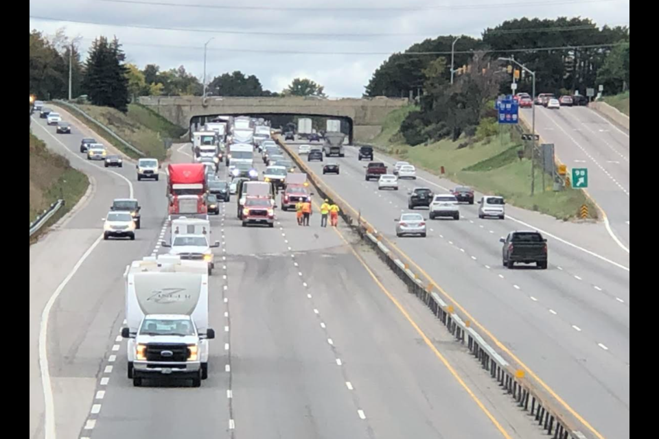 Work crews repair the barrier on Highway 400, Wednesday afternoon, following a two-vehicle crash.