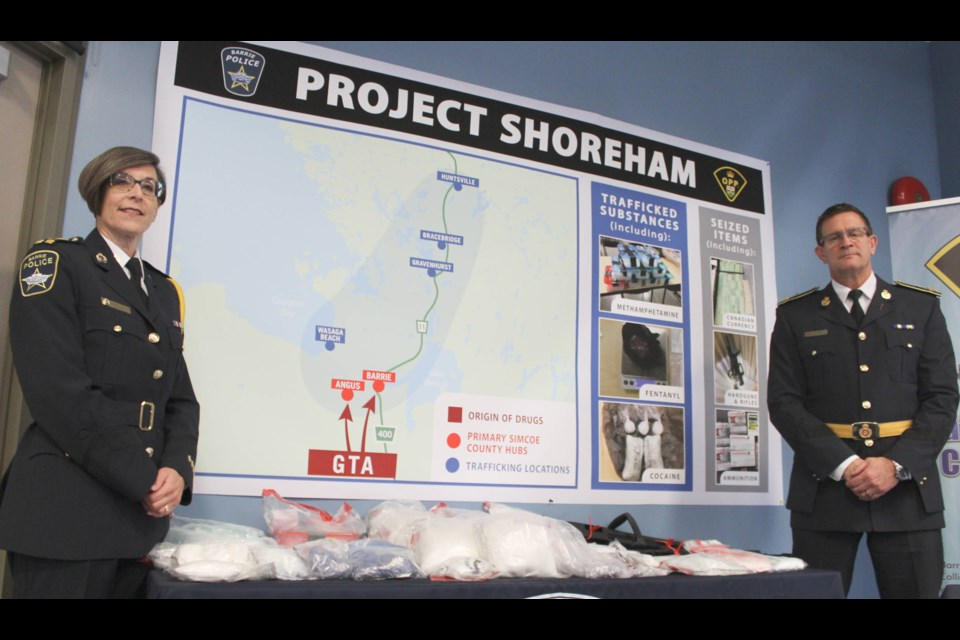 Barrie Police Chief Kimberley Greenwood and OPP Deputy Commissioner Chuck Cox stand in front of a map outlining how police say a drug distribution worked in Simcoe County and Muskoka, following a news conference at Barrie police headquarters on Tuesday, Nov. 19, 2019 about Project Shoreham. Raymond Bowe/BarrieToday