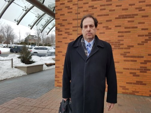 Lawyer Sheldon Wisener stands outside the Barrie courthouse today after speaking with his 14-year-old client who has been charged with the first-degree murder in the death of a 15-year-old male on Penvill Trail. Shawn Gibson/BarrieToday