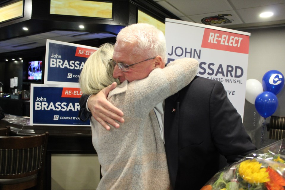 John Brassard shares a hug with his wife, Liane, after giving his victory speech Monday, Oct. 21, 2019 at the BMC. Raymond Bowe/BarrieToday