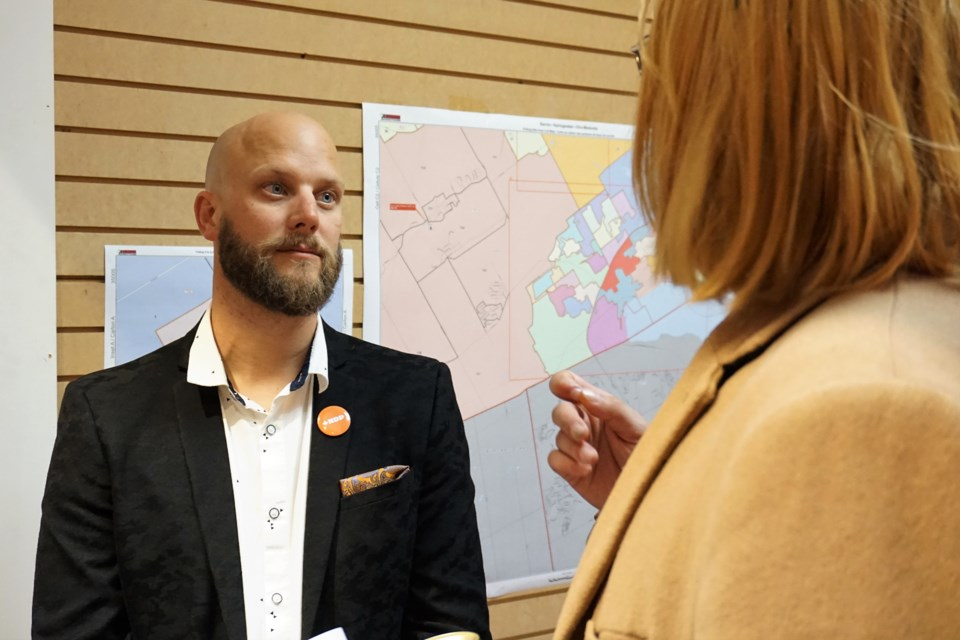 Barrie-Springwater-Oro-Medonte NDP candidate Dan Janssen chats with supporters on Monday night. Jessica Owen/BarrieToday