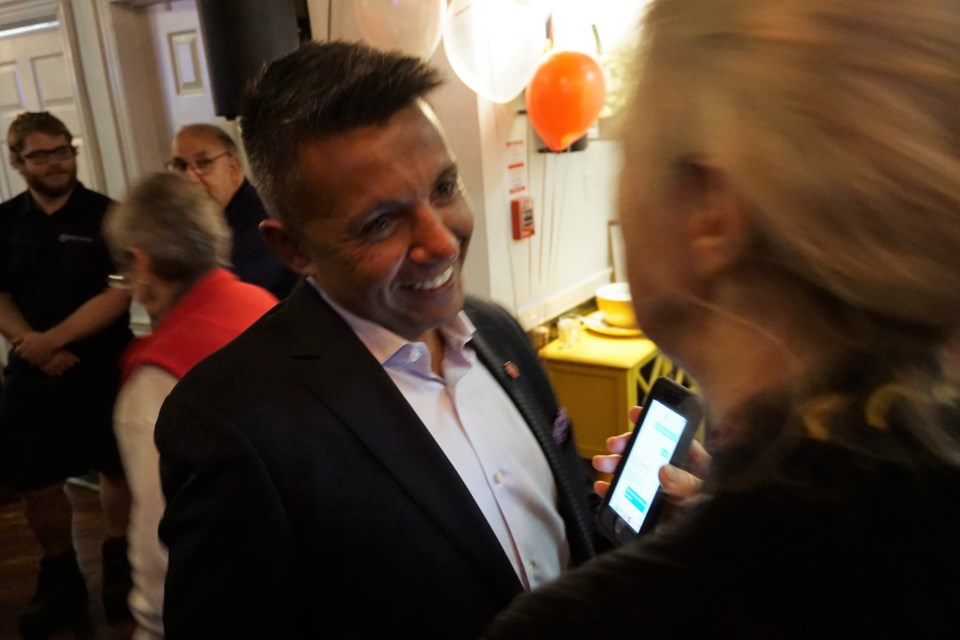 Barrie-Springwater-Oro-Medonte Liberal candidate Brian Kalliecharan hugs supporters at his campaign party, Monday night. Jessica Owen/BarrieToday