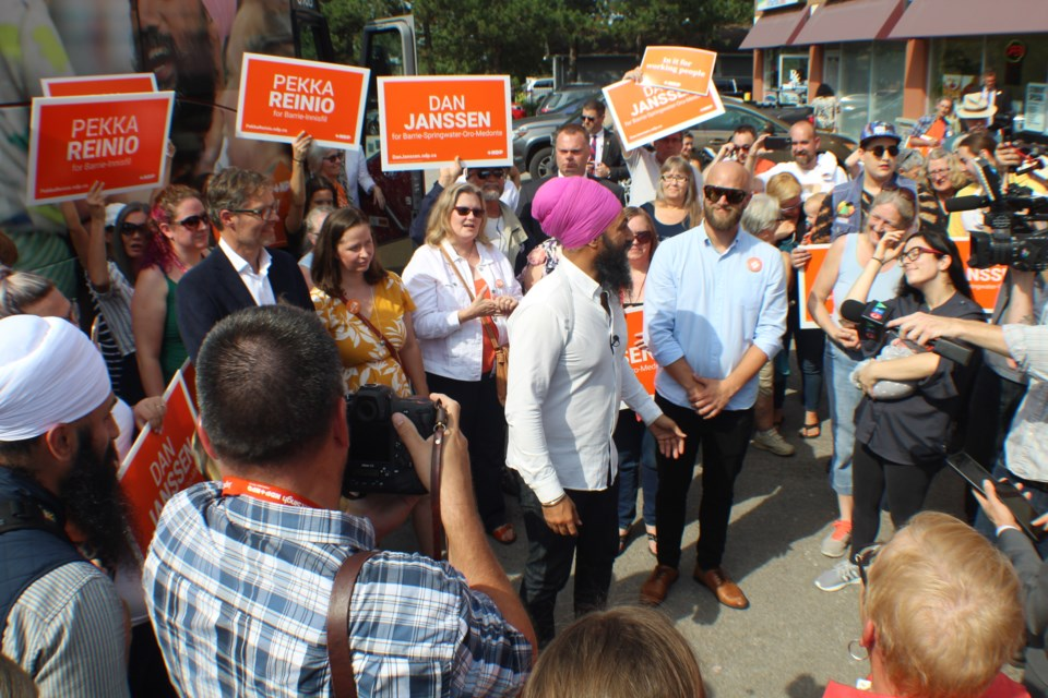Newmarket-Aurora NDP candidate Yvonne Kelly (white jacket) and York-Simcoe NDP candidate Jessa McLean stand behind NDP leader Jagmeet Singh as he speaks to supporters during a stop in Barrie on Sept. 18, 2019. Raymond Bowe/BarrieToday