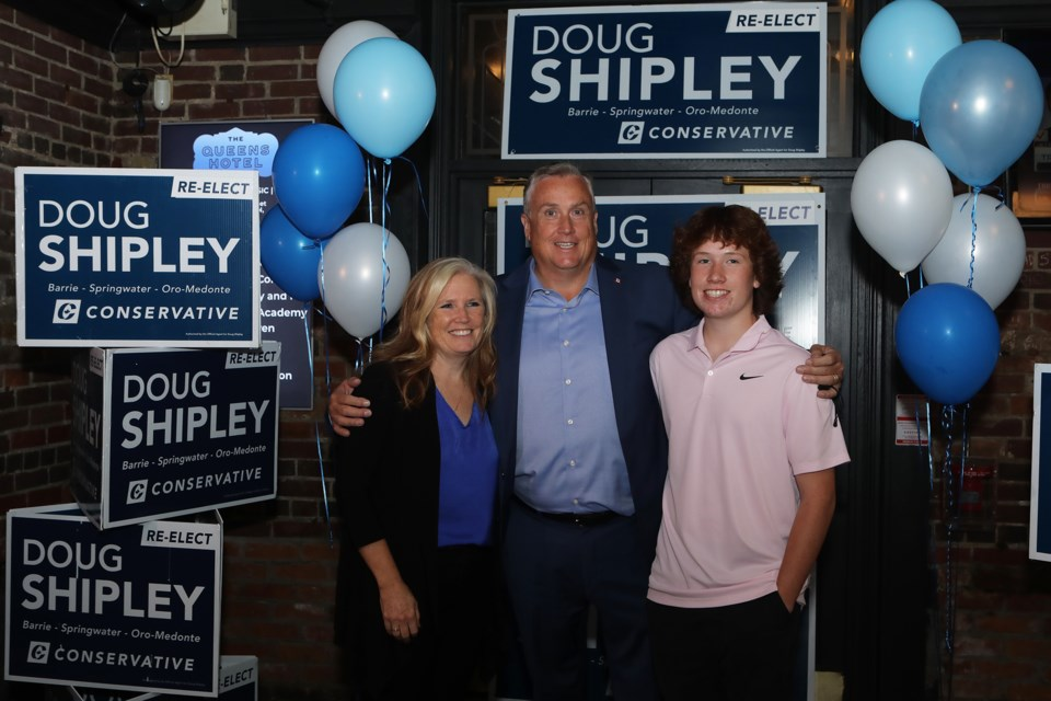 Conservative candidate Doug Shipley joins with his family members after winning in Barrie-Springwater-Oro-Medonte, Monday night.