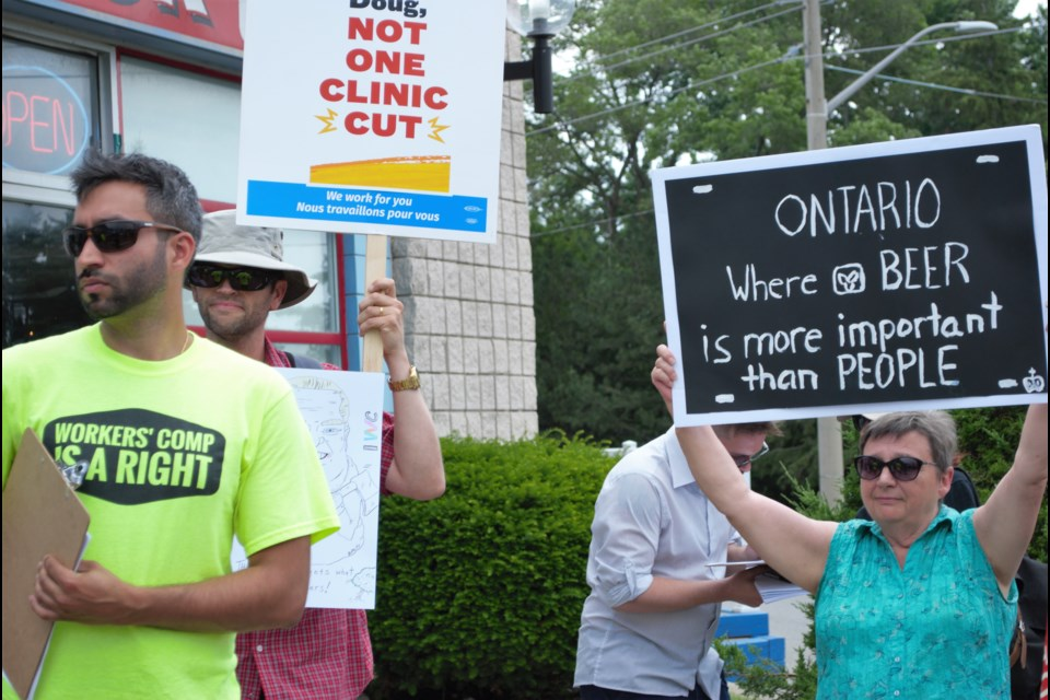 Protestors at MPP Doug Downey's office voiced their disapproval about cuts to Legal Aid Ontario. Jessica Owen/BarrieToday