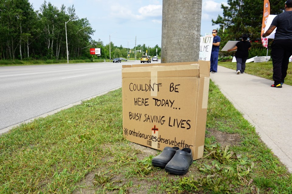 Nurses took to a busy section of Mapleview Drive and Huronia Road on Monday afternoon to protest Bill 124. Jessica Owen/BarrieToday