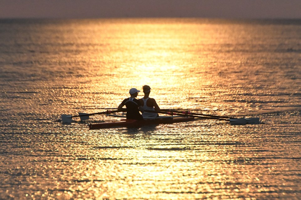 Barrie Rowing Club members Cheryl Arends and Sara Richardson enjoy a wonderful sunrise over Kempenfelt Bay earlier this week. Ian McInroy for BarrieToday