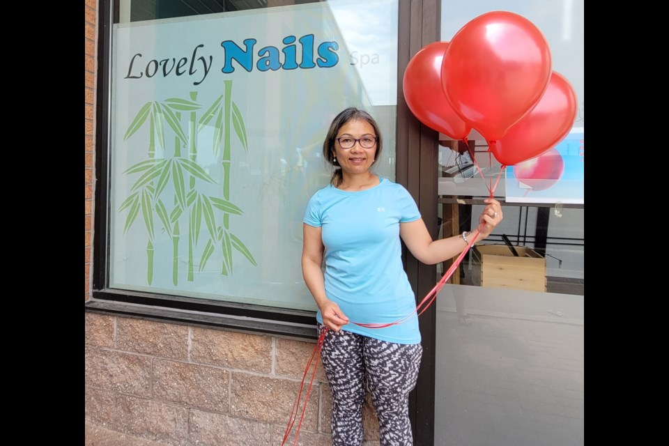 April Hoegy stands in front of her Lovely Nails Spa and says she will continue to fight to pressure the province to allow her to reopen.