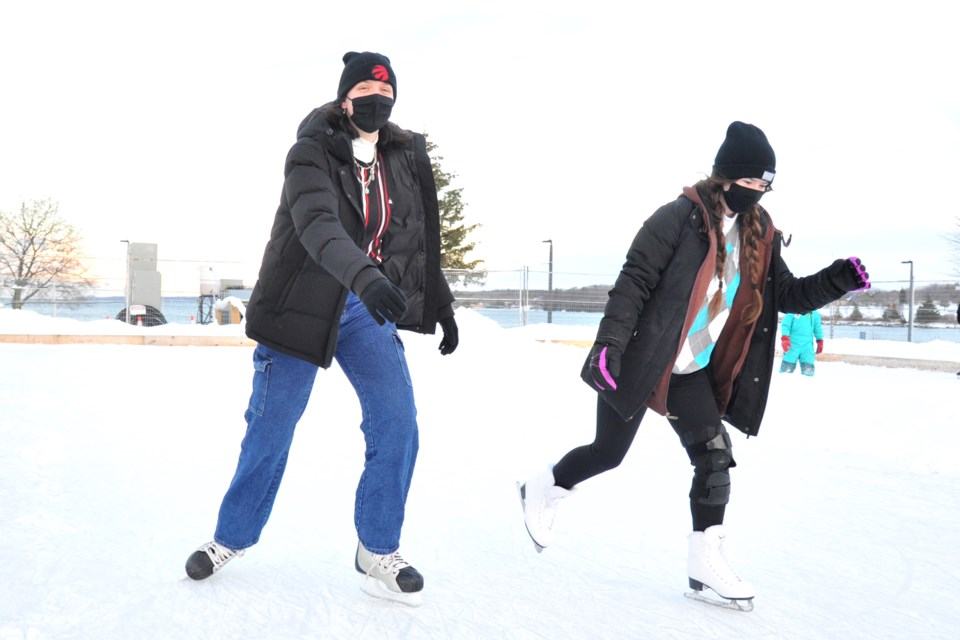 Halcyon, left, and Alyssa take to the ice at Barrie's Centennial Park Community Ice Rink for some fresh air.