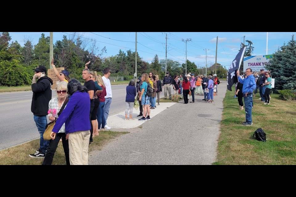 Protesters stood by Georgian Drive outside Barrie's Royal Victoria Regional Health Centre on Monday.