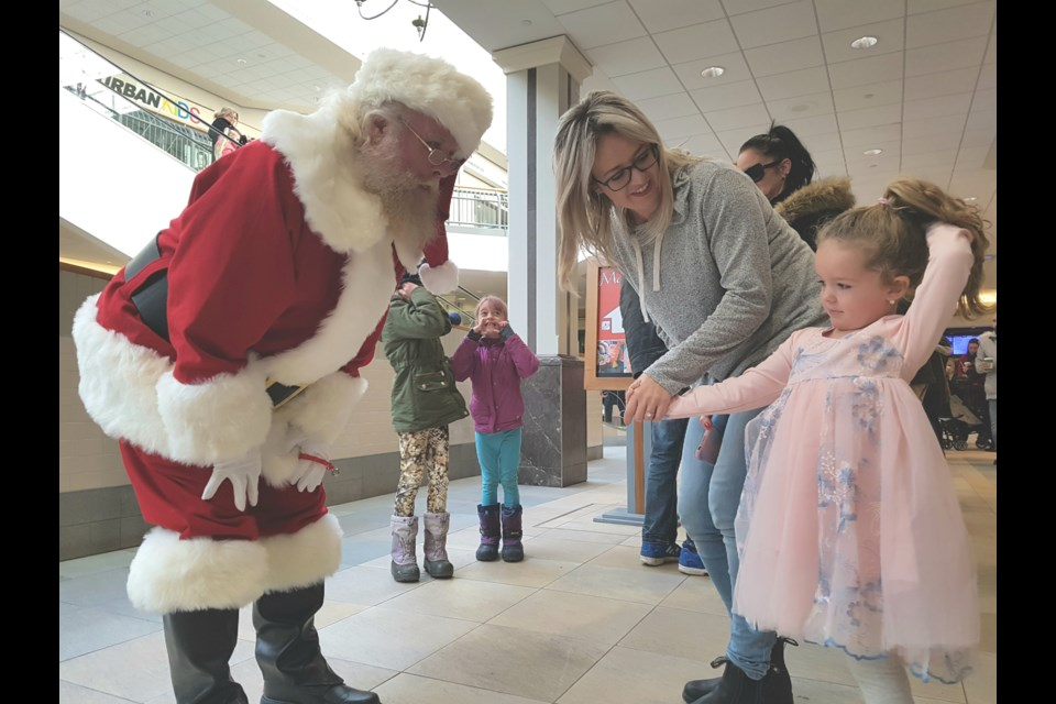Santa Claus greets a shy three year old Riley  at the Santa Arrival and Breakfast at Georgian Mall, Saturday Nov. 16, 2019. Shawn Gibson/BarrieToday