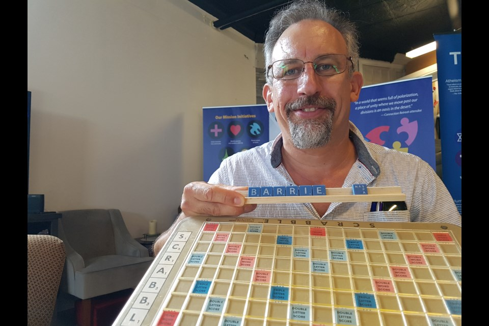 Michael Zacharko gets ready for league night at the Barrie Scrabble Club, Wednesday. Shawn Gibson/BarrieToday