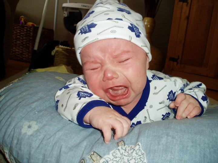 Peter Robinson's infant son in his Toronto Maple Leafs attire.