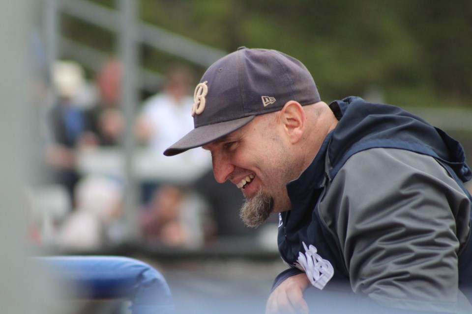 Barrie Baycats manager Angus Roy shares a laugh with his players in the dugout. Raymond Bowe/BarrieToday