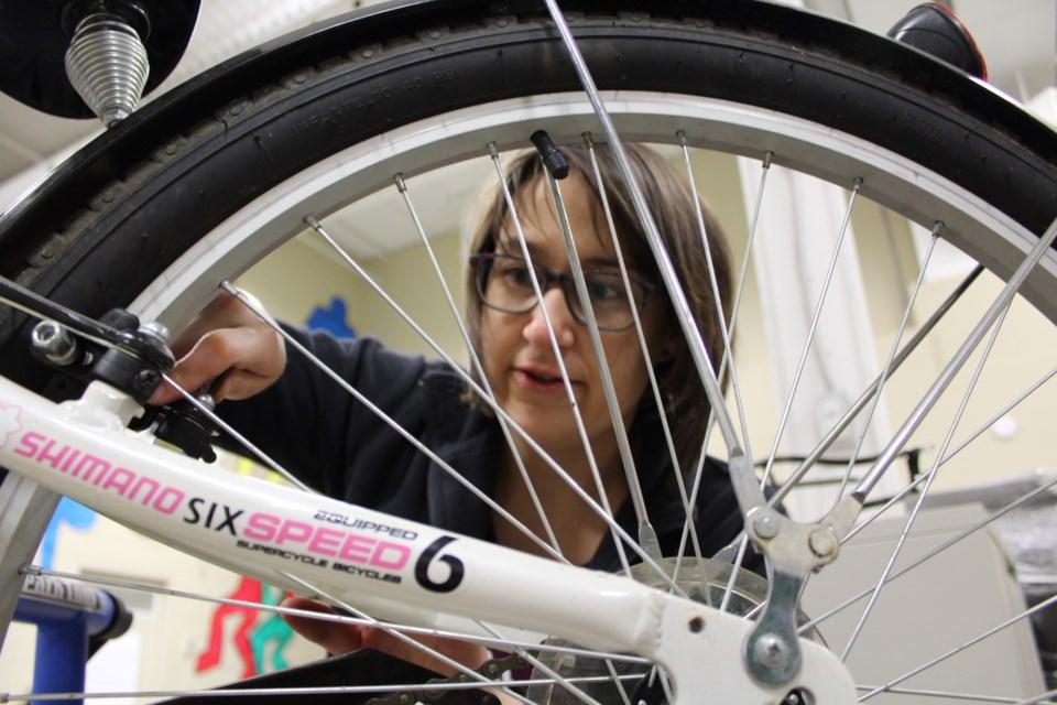 Chantale Boileau takes part in Firebird Community Cycle's 10-week Revolution program this week on Anne Street. Raymond Bowe/BarrieToday