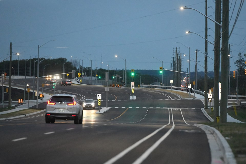 After several months of waiting, the bridge over Highway 400, connecting Harvie Road and Big Bay Point Road in south-end Barrie,opened to vehicle traffic and pedestrians on Thursday night. The new bridge is east of the intersection of the as-yet-to-be built Bryne Drive extension, connecting Essa Road to Mapleview Drive, which already has a set of traffic lights (foreground). A line of distant Big Bay Point Road traffic lights can be seen at centre right.