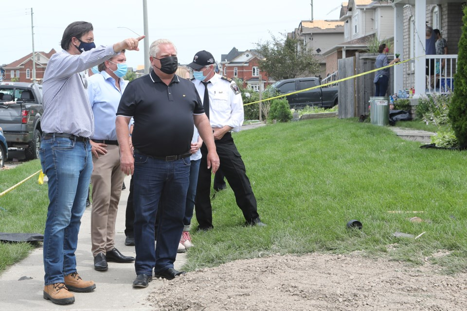 On Friday, Premier Doug Ford toured a neighbourhood in south Barrie devastated by an EF-2 tornado. Here he is shown touring the area with Barrie Mayor Jeff Lehman and emergency services personnel.