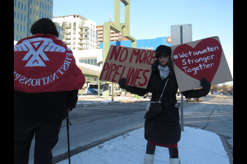Sarah Cunnigham Gahondee  shows her support for the  Wet'suwet'en First Nation as she held signs on Collier Street, Saturday, Feb. 8, 2020. Shawn Gibson/BarrieToday