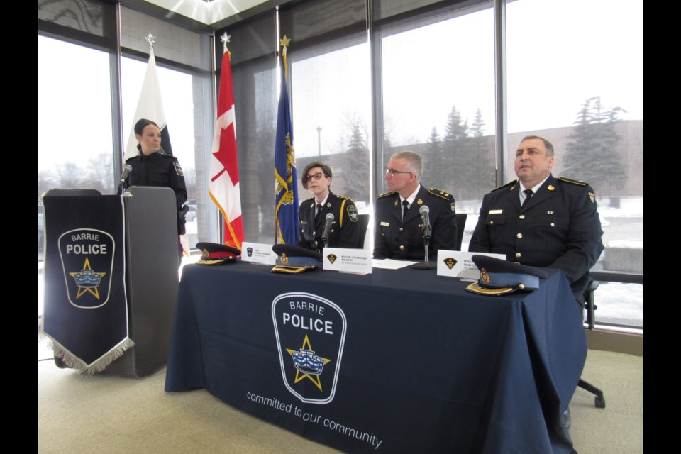 Constable Sarah Bamford watches over the day's press conference. Shawn Gibson for BarrieToday