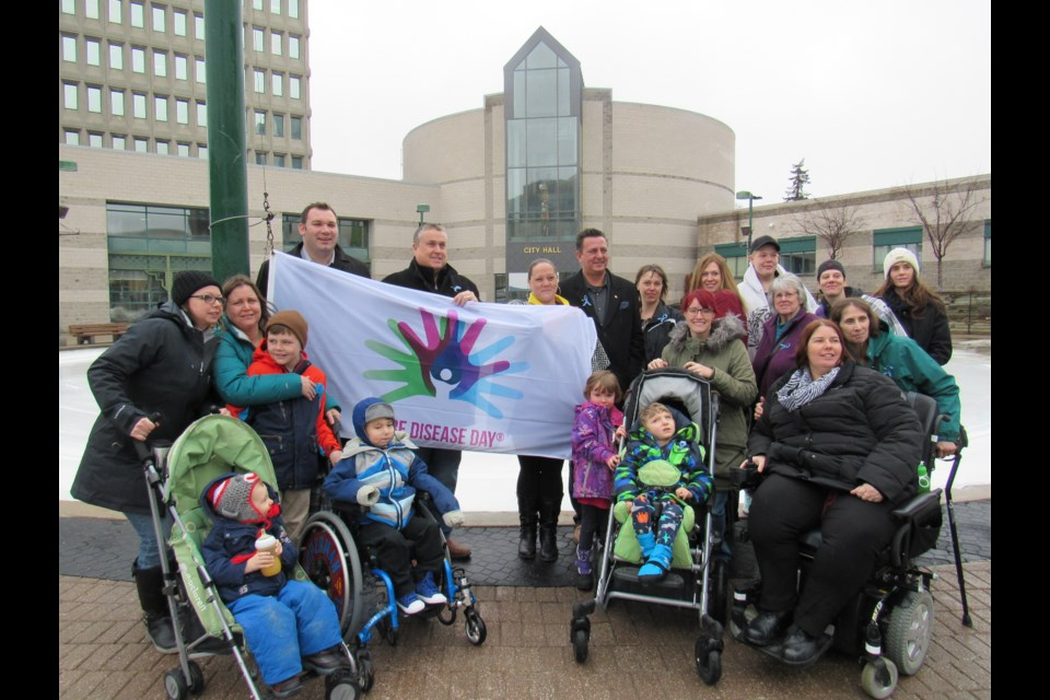 Flag raising at City Hall for Rare Disease Day. Shawn Gibson for BarrieToday