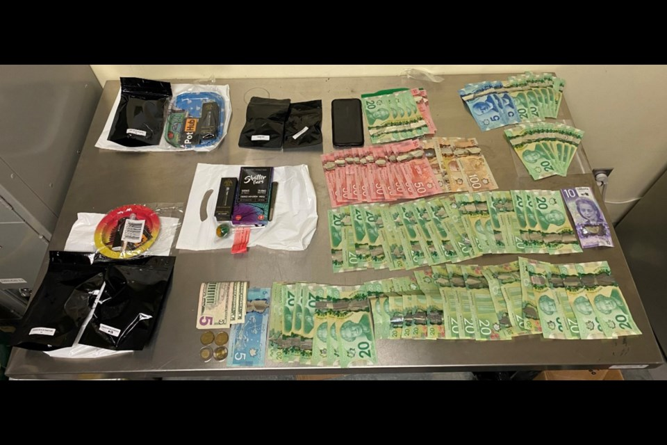 Drugs, currency and weapons were seized by Orillia OPP in Friday night's drug investigations. Photo supplied by OPP