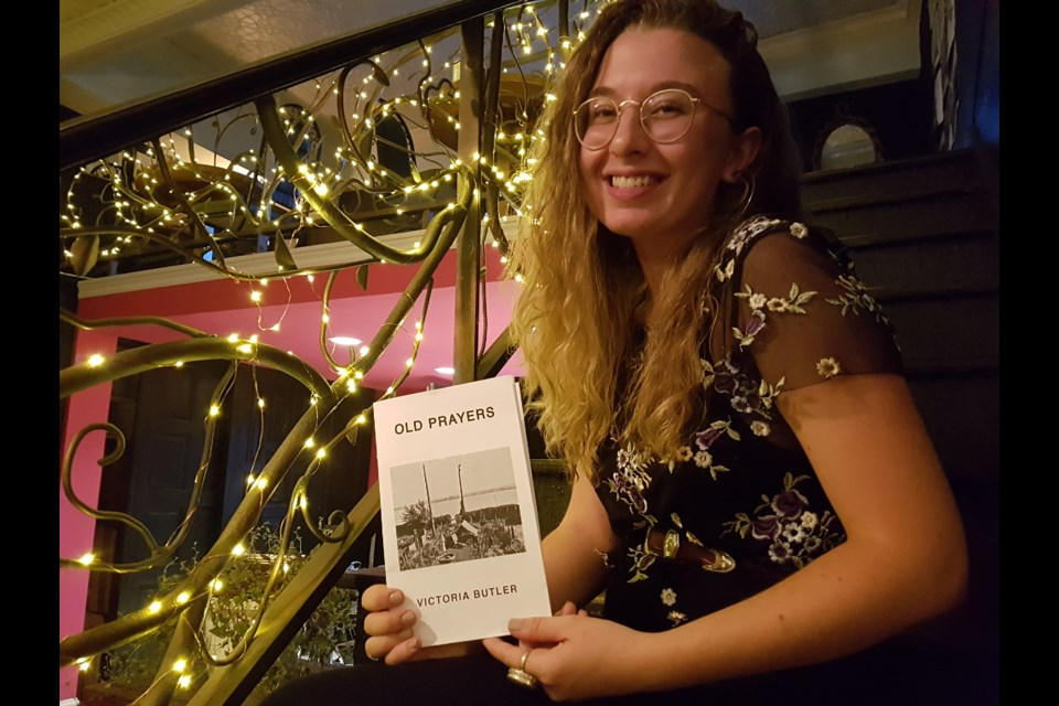 Victoria Butler shows off her newest work, Old Prayers, at a reading on Friday night. Shawn Gibson/BarrieToday