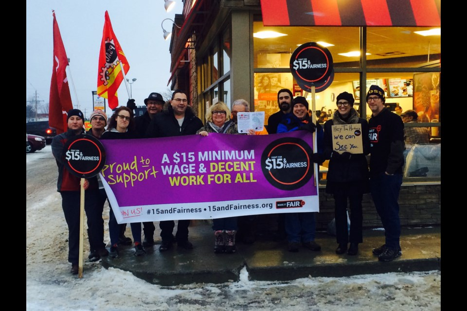 Information Rally outside Tim Hortons location wants clawbacks to workers benefits and paid breaks reversed