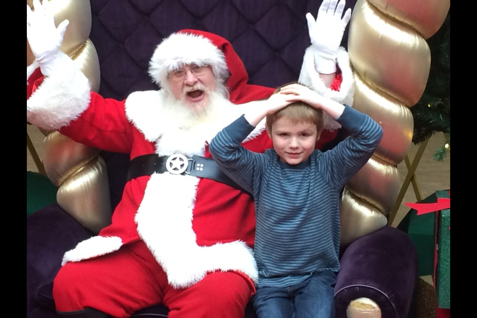Zakery Rumph enjoys his visits with Santa as part of the Sensitive  Santa event