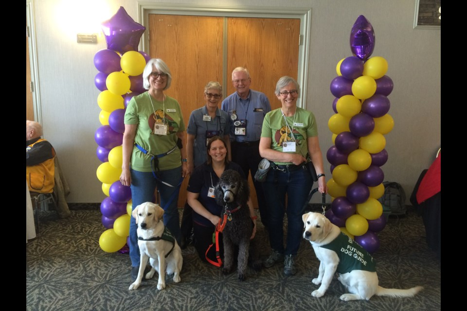 (l-r) Linda Kittmer with foster dog Shay, Janet Marissen Lions Foundation of Canada Dog Guides, Harry Marissen, foster dad, Anne McDougall foster mom to Freddy and  Melanie Pigeau  (kneeling) with Tetris.