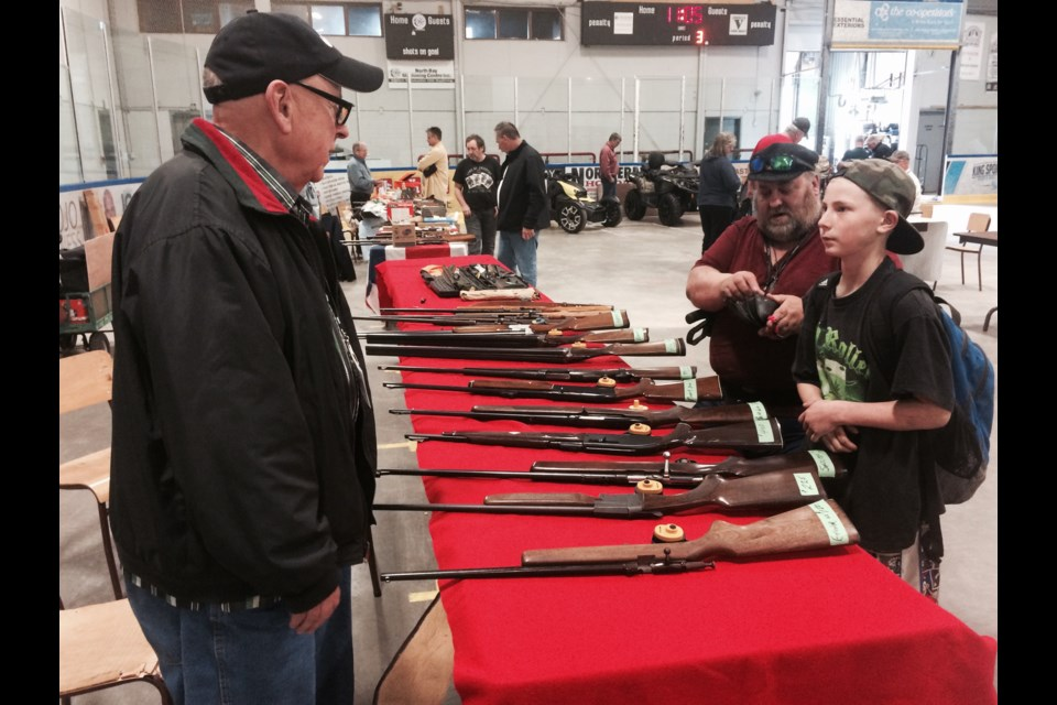 Trapper and hunter Jim Swackakmer adds to his gun collection at the Rock Cut Shooting Club inaugural gun show