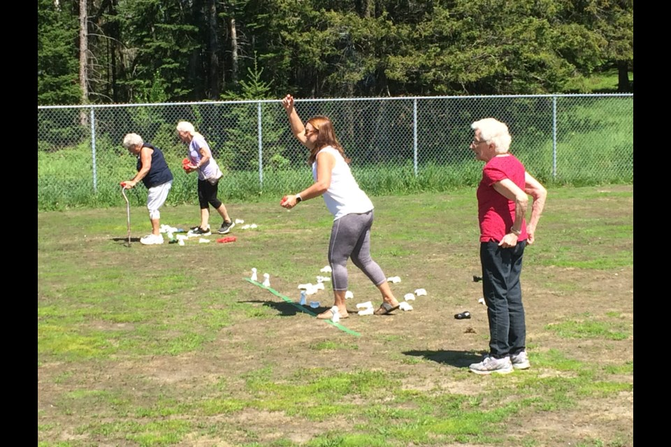 """Terri Moore (throwing) and Jeanne Knight team up for a game on """"Bones"""" at the East Ferris 50+ Senior Games"""