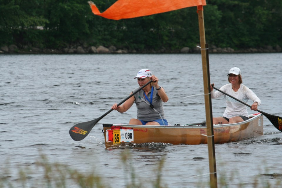 Ellen Padzdior (bow) and Bonnie Pankiw set a record in C2 Stock Women's Class with a time of 7:47:37 smashing previous record of 9:00:12