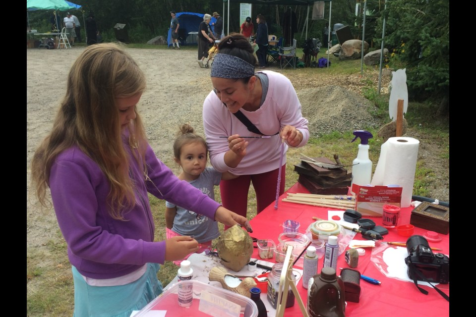 Katelyn Kash (l), Maya Granger, and Sarah Vincent enjoy doing crafts at the 6th annual Louise de Kiriline Lawrence Nature Festival