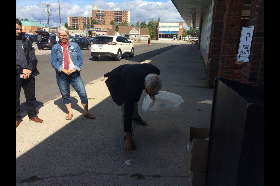North Bay and District Chamber of Commerce President Peter Chirico does his part by picking up litter during the Clean Green Beautiful news conference Thursday